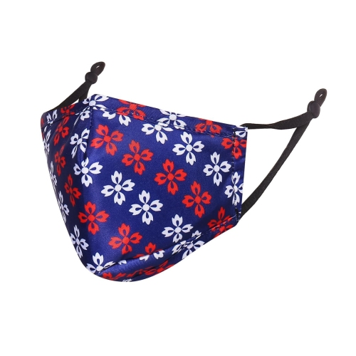 A navy reusable face mask for children with red and white flower type icons on it