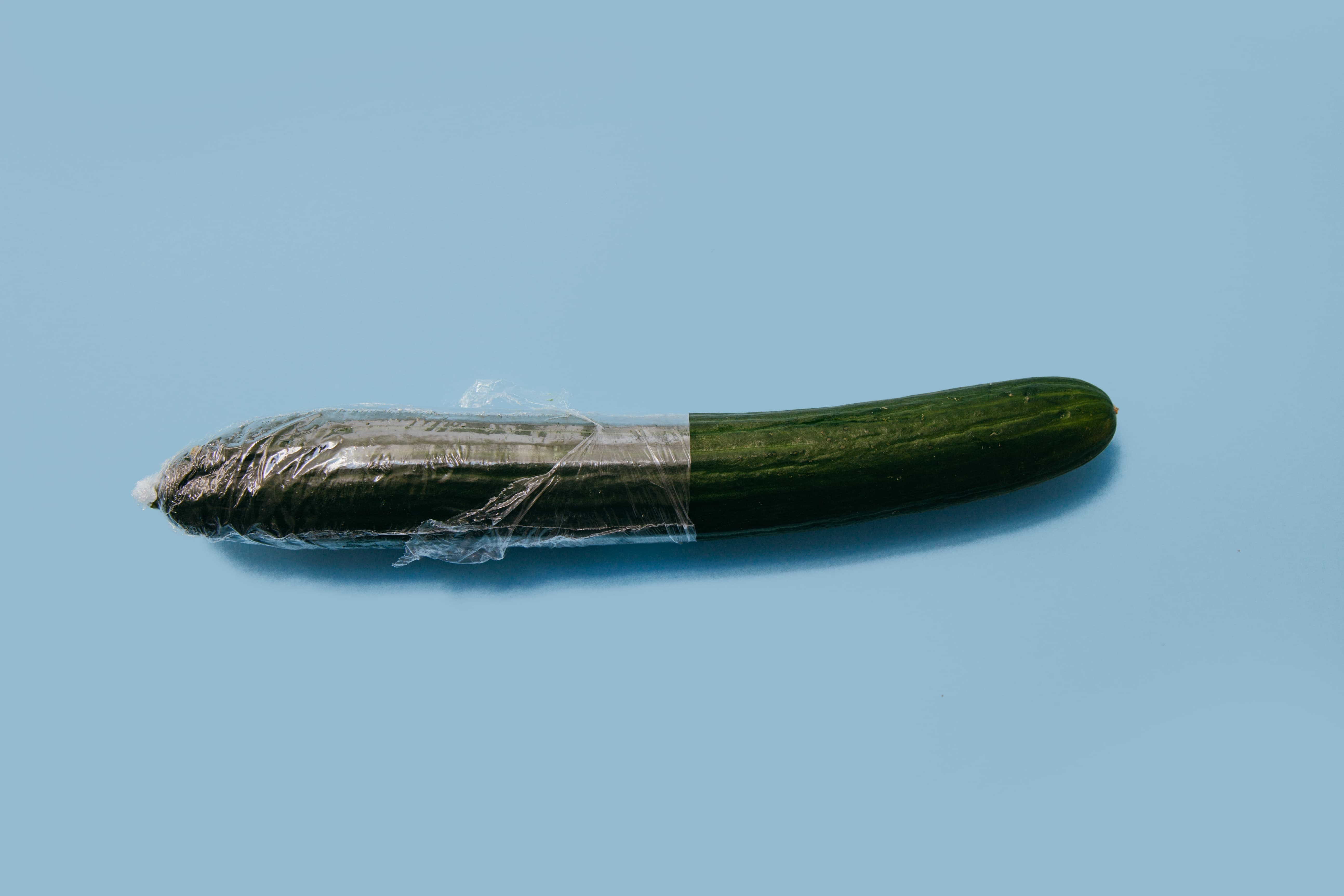 A cucumber with a condom