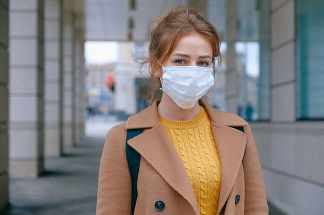 Lady wearing a face mask to protect from viruses such as covid-19