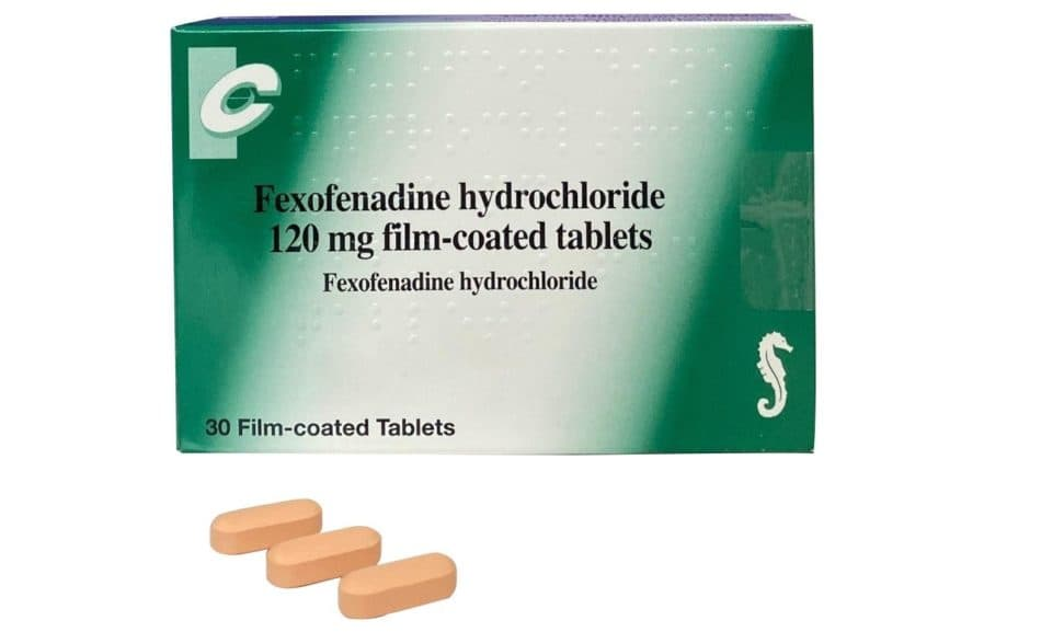 Green box of chanel branded 120mg fexofenadine with 3 loose tablets in front of it
